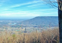 Lookout Mountain viewed from Raccoon Mountain. Lookout Mountain is home to Rock City, Ruby Falls, and the Incline Railway in Chattanooga, Tennessee. The Tennessee River is visible at the foot of the mountain.