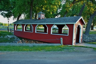A covered bridge protects the path from the park to town.