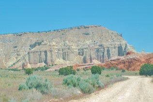 The time-chiseled facade of the cliffs suggest an ancient temple in the haze