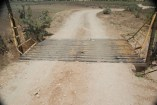 A cattle guard prevents cattle from straying into park land.