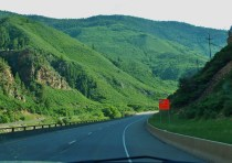 Once on the western slope of I-70, the mountains take on a green mantel of vegetation.