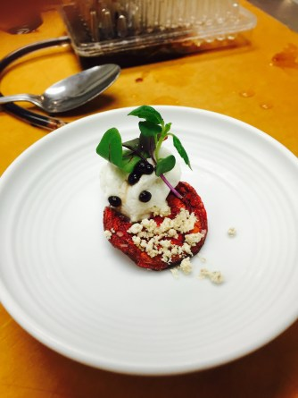 Beet chip with honey and blue cheese foam, pistachio powder, and balsamic 'caviar'
