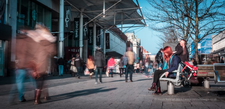 Street Photography - ISO100 F29 .5sec, Again love how the girl sits still and the world rushes past.