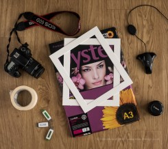 A flatlay showing some of the components needed to present images.