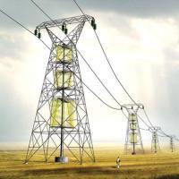 Turbinas de viento en torres de alta tensión