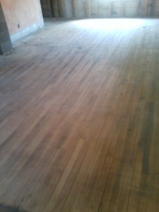 The living room floor, we ripped out the carpet and this is what was under it :) We think it's fir, can't wait to refinish it!