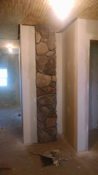 Covering a block chimney in new rock in a 100 year old farm house