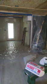 Covering everything with plastic before starting on spraying primer in the whole house!