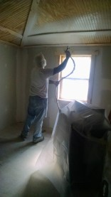 Spraying primer in a 100 year old farm house
