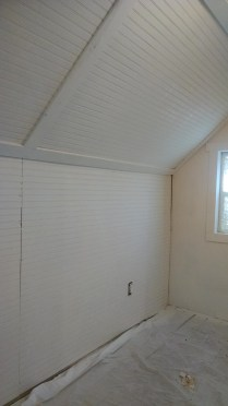 We chose to cover the slanted walls/ceilings in the master bedroom and keep it all flat white.