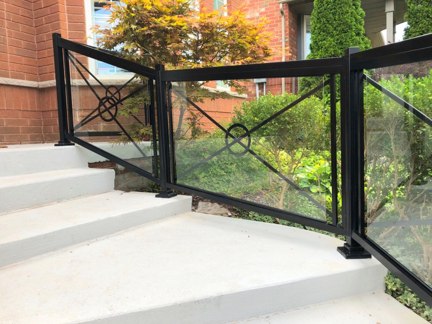 Renaissance Rail aluminum and glass railings, black, with Circle X-Frame decorations, on a concrete front entrance in Hamilton, ON