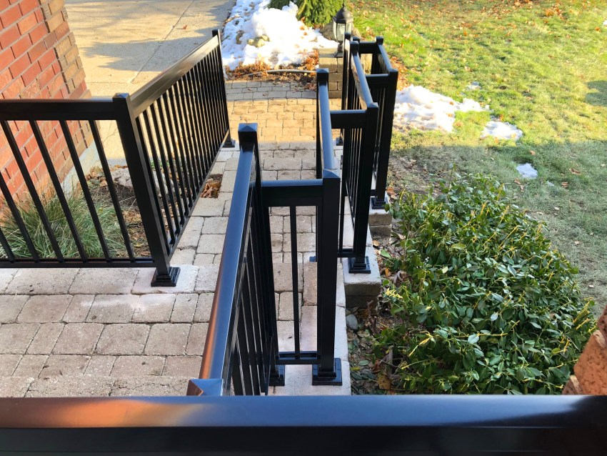 Renaissance Rail aluminum spindle railings, black, on an interlock front entrance in Mississauga, ON