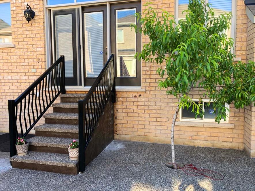Renaissance Rail aluminum spindle railings, black, curved, on a back porch in Burlington, ON