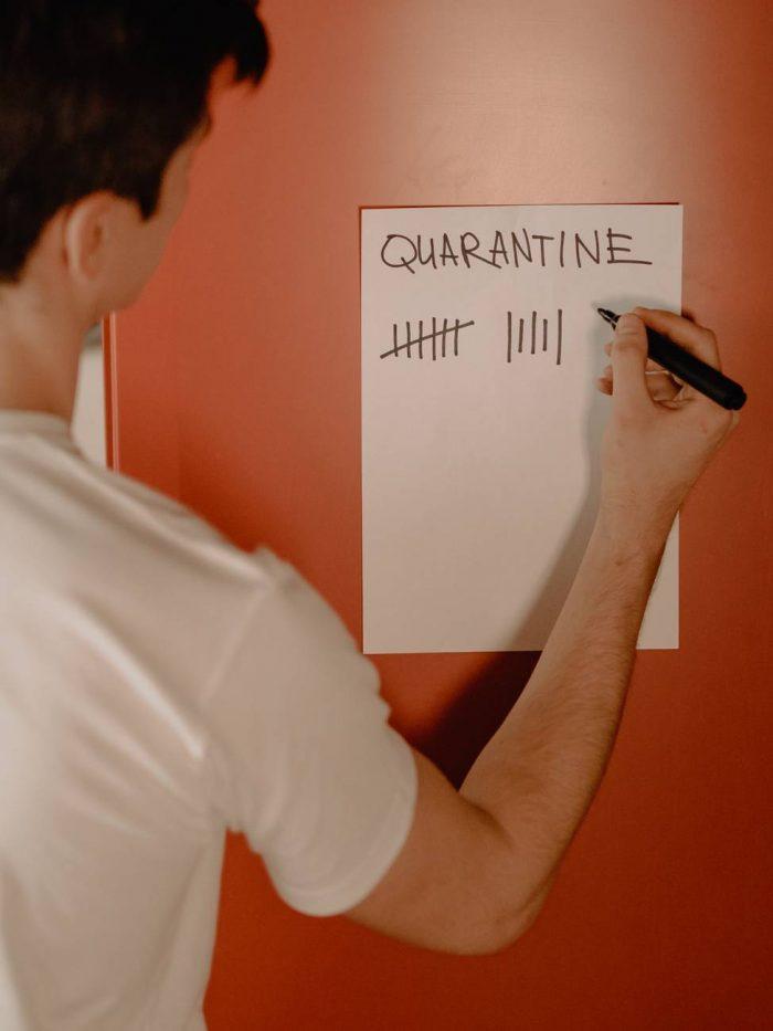 man marking quarantine days
