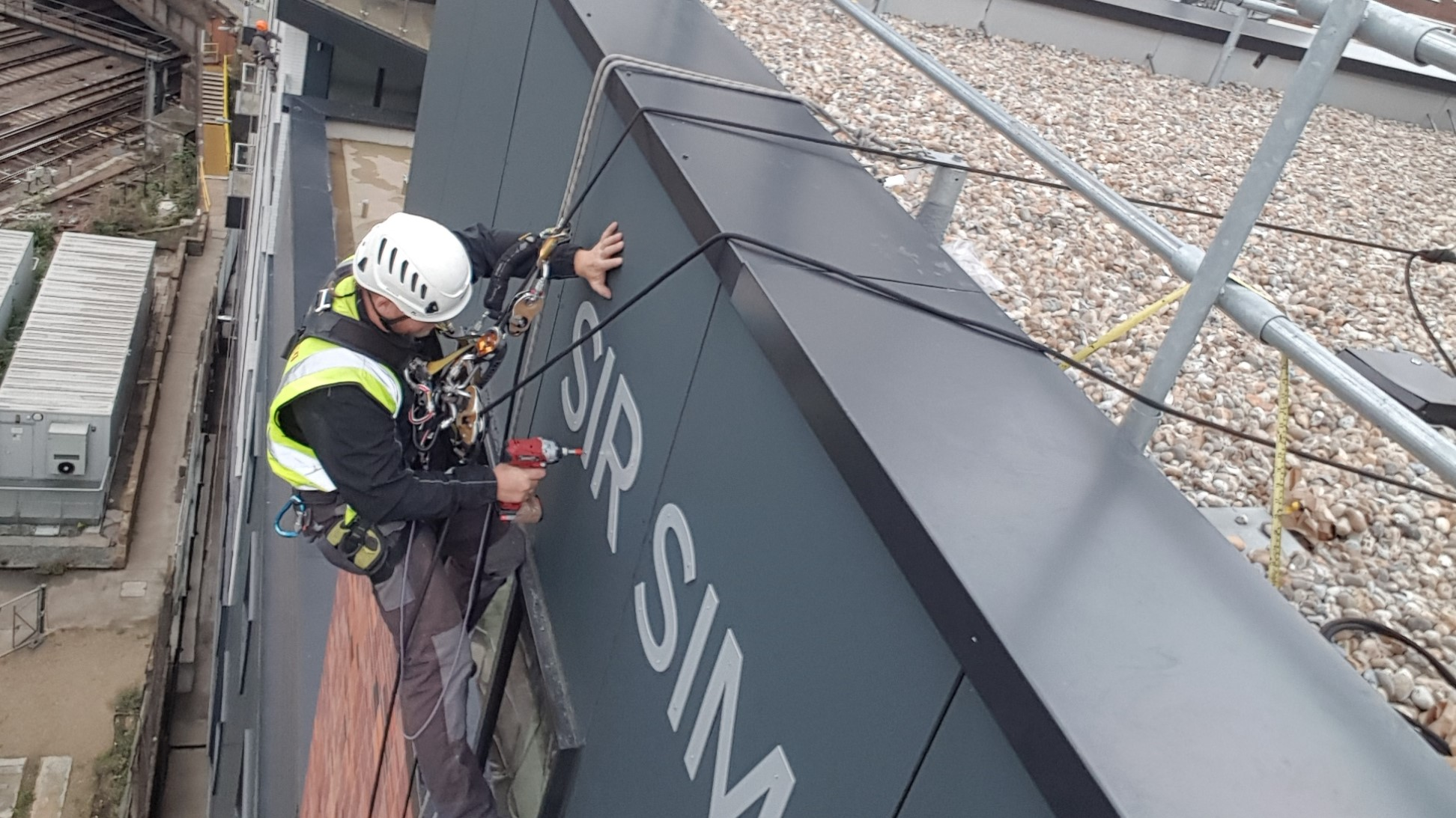 rope access sign banner installation