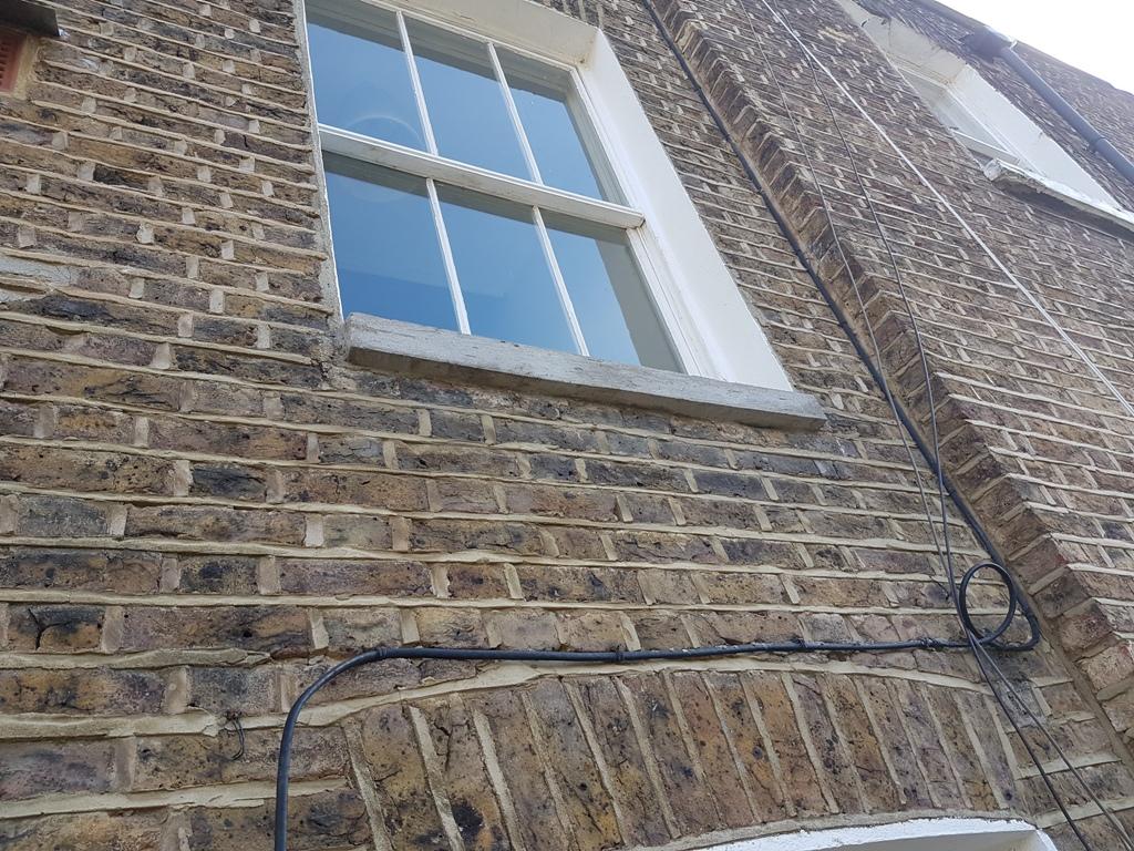 rope access concrete window sill repair