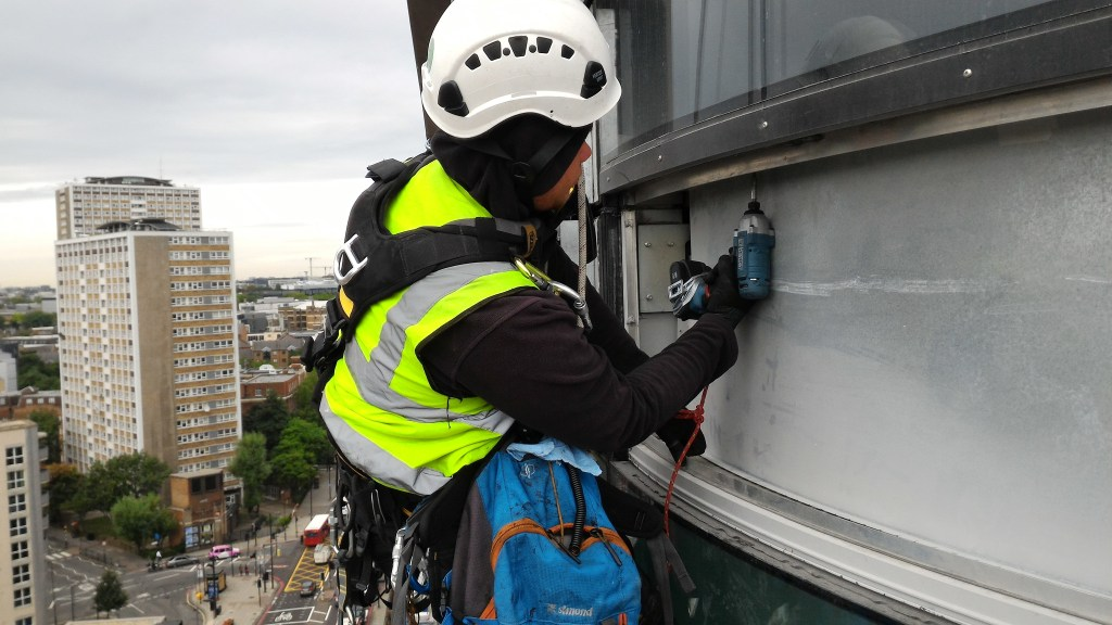 rope access curtain wall installation
