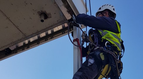Abseiling cladding installation
