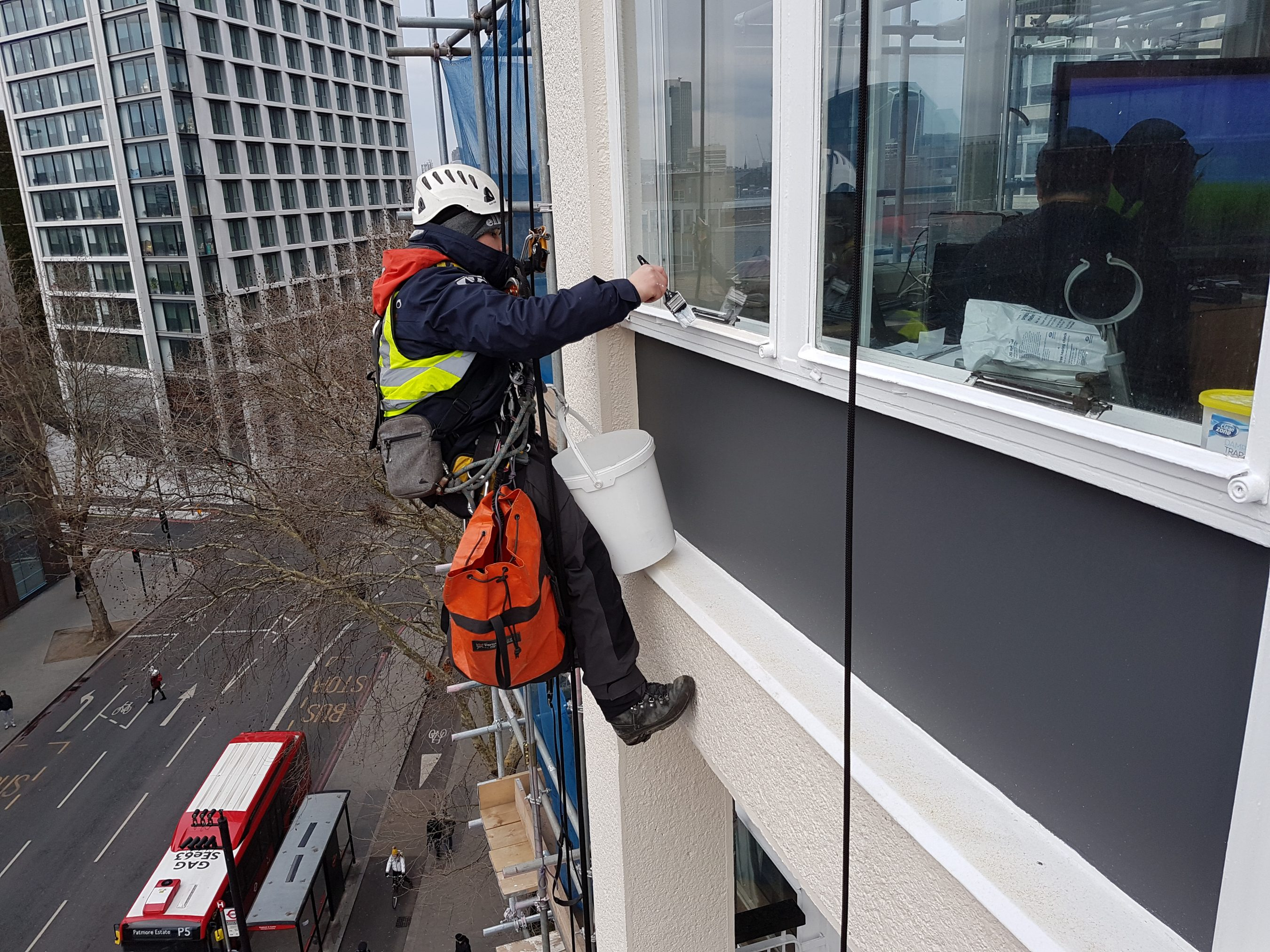 rope access metal window painting