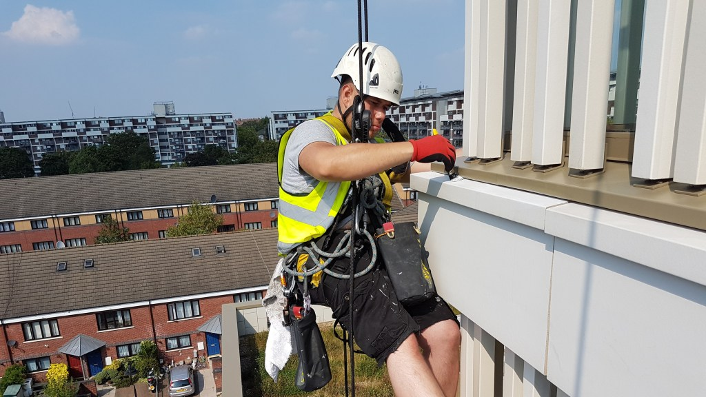 high rise building painting abseiling