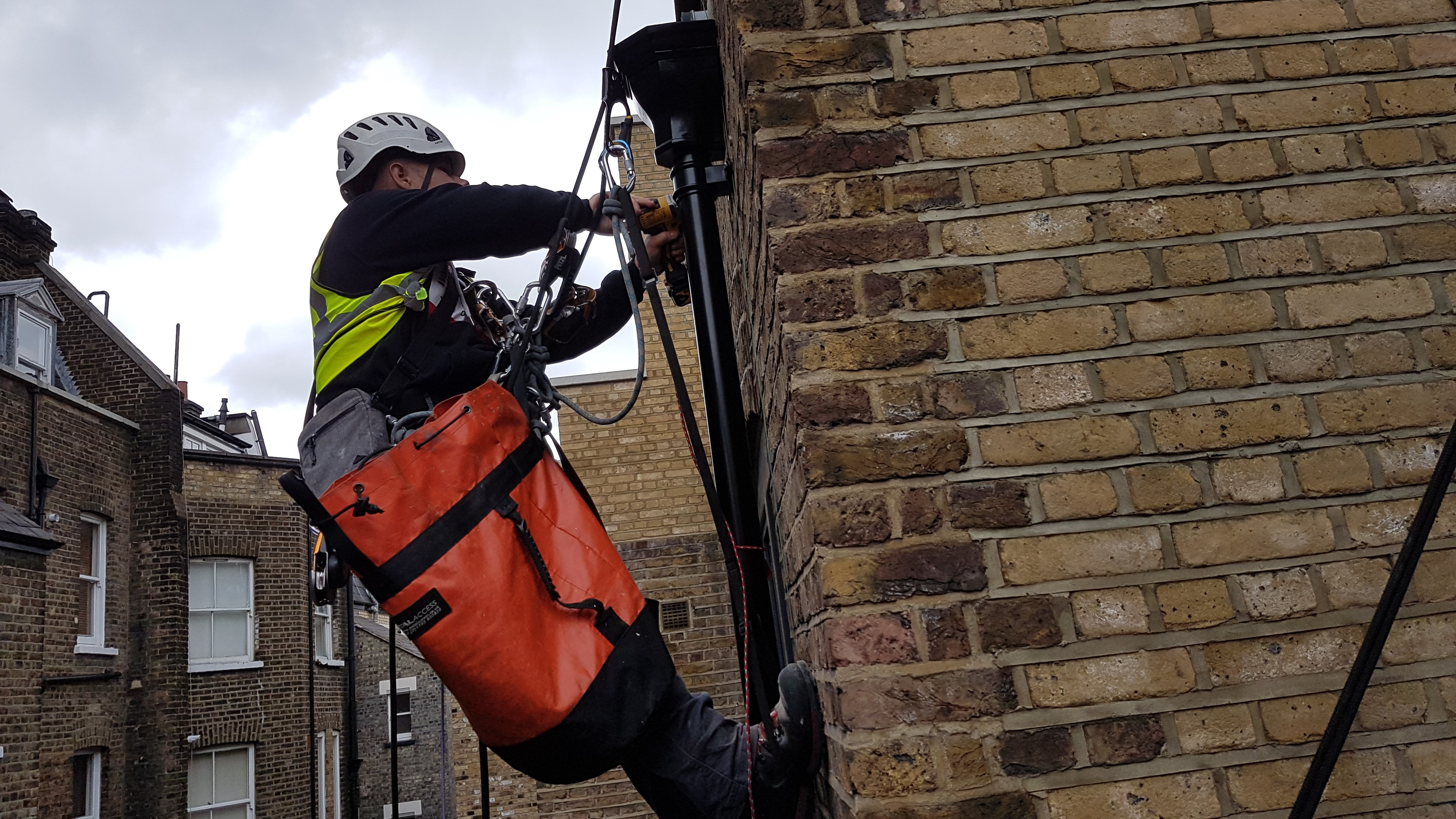 abseiling down pipe installation