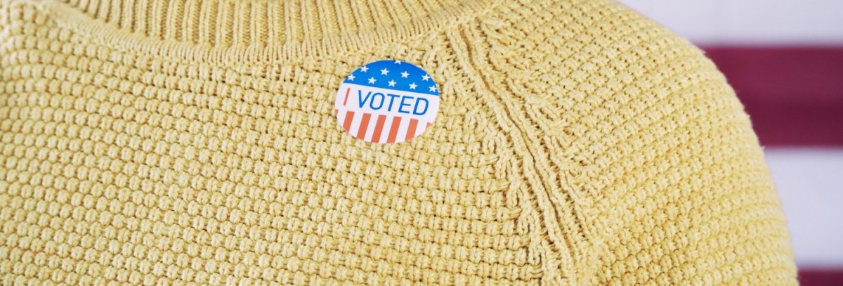 Woman-wearing-voter-sticker-630136