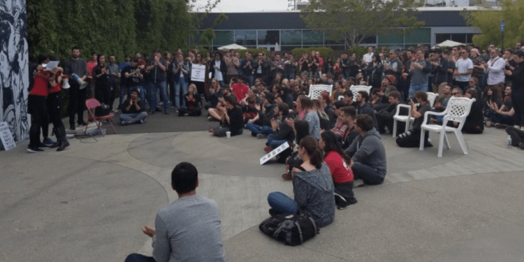 Riot Games employees sit down