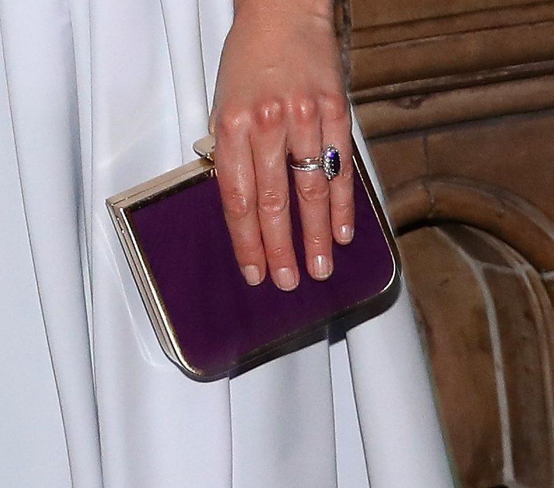 Jerome C Rousseau purple clutch