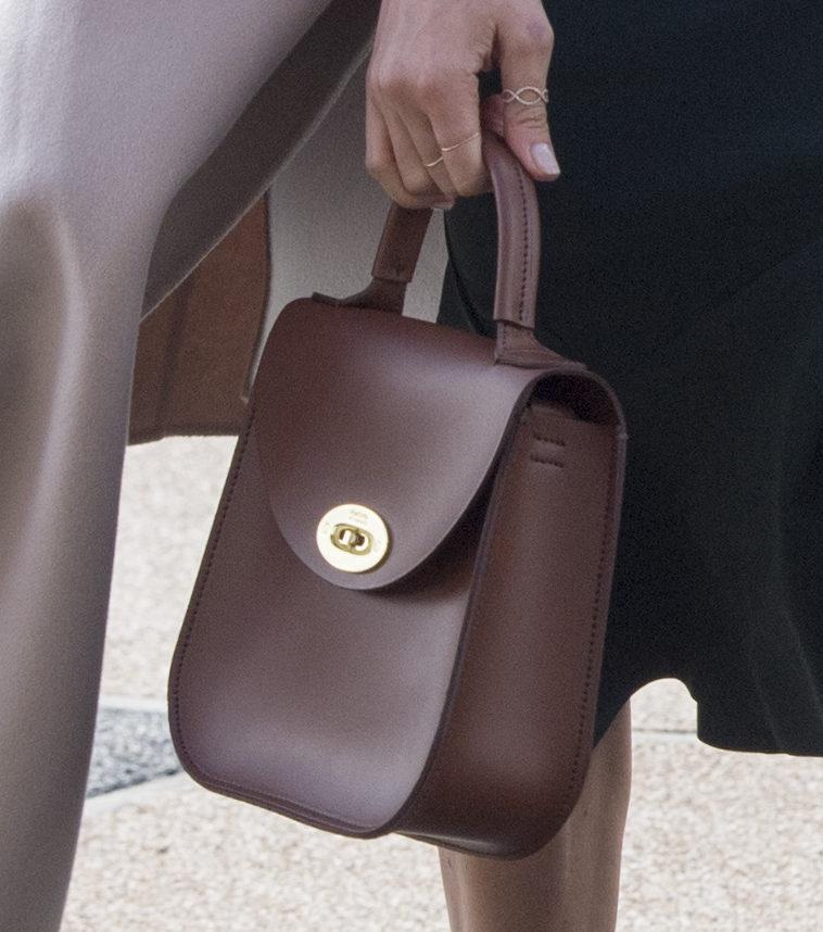 Meghan Markles Charlotte Elizabeth bag brown bag. Picture by POOL / i-Images