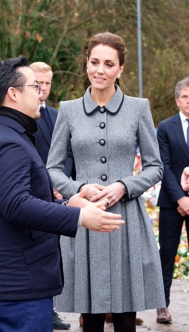 The Duchess of Cambridge wears a bespoke Catherine Walker coat to pay respects to those killed in the Leicester City football club helicopter crash (Kensington Palace)