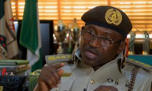 Comptroller-General of Immigration Tests Positive to Covid19 boss coronavirus
