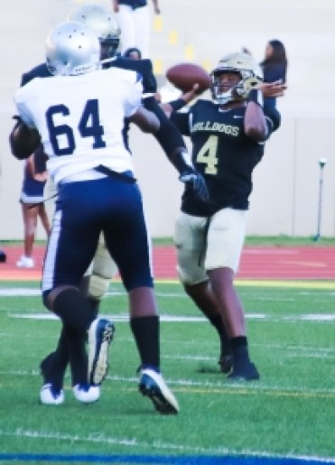 Lithonia's Savion Lawson (4) throws for one his five touchdown passes against Redan in the Bulldogs' 42-0 win. (Photo by Mark Brock)