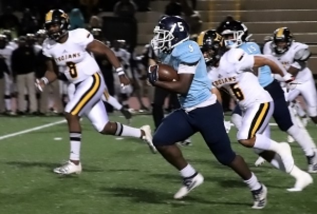 Cedar Grove's Chavon Wright (5) gets way for a 45-yard gain against the Peach County defense. (Photo by Mark Brock)