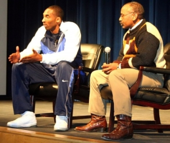 The late Kobe Bryant (left) speaks with athletes and students at Columbia High in 2007. Columbia head boys' basketball coach Phil McCrary (right) led the question and answer session. (Photo by Mark Brock)