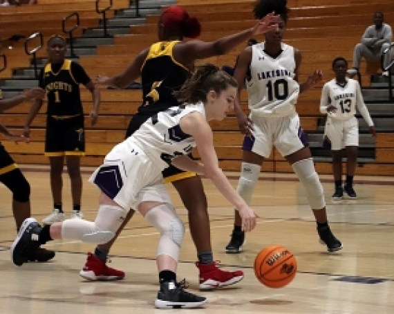 Lakeside's Ella Steed (22) dribbles past a Central Gwinnett defender. (Photo by Mark Brock)