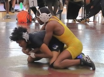 Stephenson's Damonie Young (left) and Southwest DeKalb's Jaheim Williams had a big match in the DCSD County Championships. but now both are qualified for the state tournament this weekend. (Photo by Mark Brock)