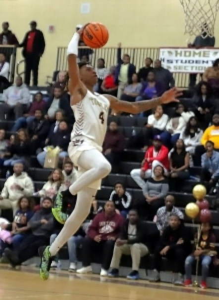 Jermontae Hill led the Tucker Tigers to a second consecutive Region 4-6A boys' title with 19 points against Lovejoy on Saturday.. (Photo by Mark Brock)
