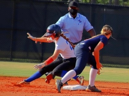 Chamblee's Margaret Axelson (left) beats the tag of Dunwoody shortstop Ryan Boaz (right) to reach second base safely. (Photo by Mark Brock)