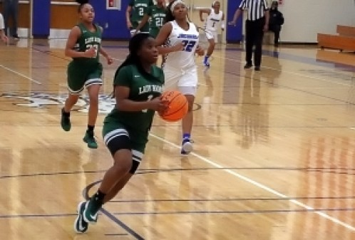 Arabia Mountain's Myori Pruitt (1) rushes up court on a fast break for a basket ahead of Stephenson's Zoey McMicken's (22) during Arabia's 55-52 win. (Photo by Mark Brock)