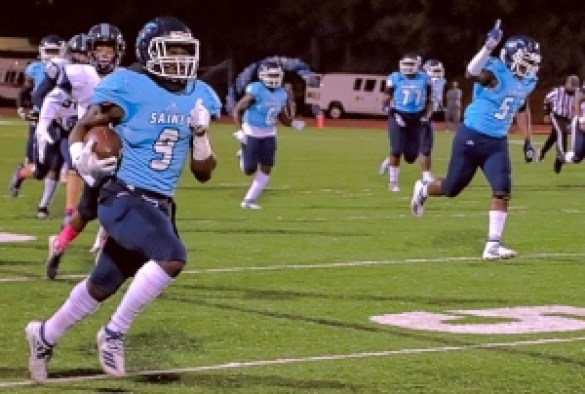 Cedar Grove's Jordan Grier (9) returns a fumble 70 yards in the first half of the Saints 40-10 win over Pace in 2019. Grier signed with Indiana University. (Photo by Mark Brock)