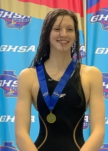 Chamblee's Kyla Maloney won her second consecutive gold medal in the 100 baskstoke and was part of two gold medal relay teams in the GHSA Class 4A/5A Girls State Swimming Championships.