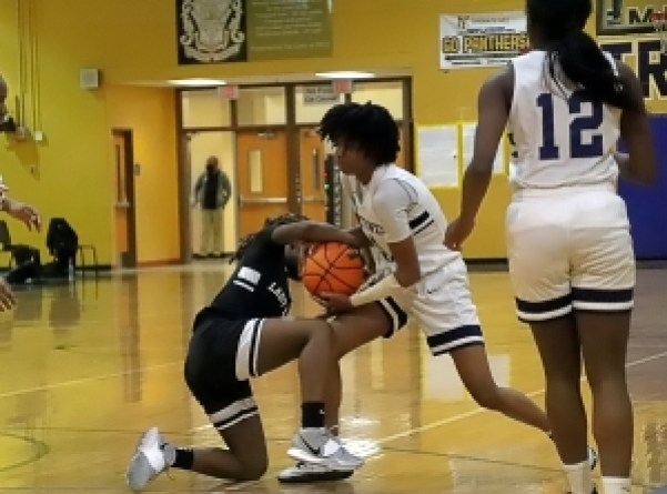 Southwest DeKalb's Pryia Thompson (4 in white) battles M.L. King's Kaya Jarvis (4 in black) for a loose ball during first half action of Southwest's 63-30 win. (Photo by Mark Brock)