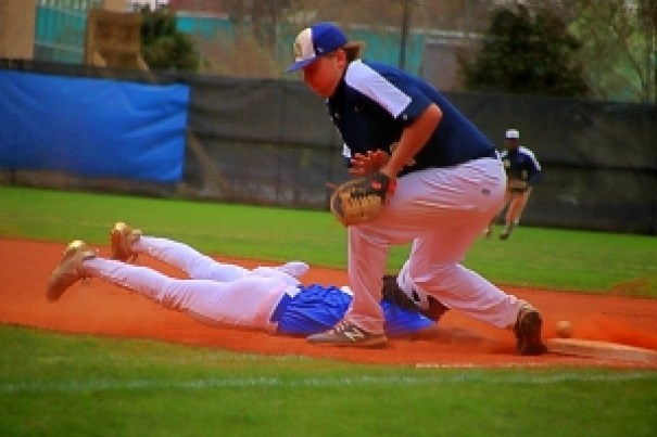 Chamblee's Sydyk Ross dives safely back into first base as Decatur first baseman James White tries to come up with a low throw on a pick-off attempt. Decatur won the Region 5-5A game 11-3. (Photo by Mark Brock)