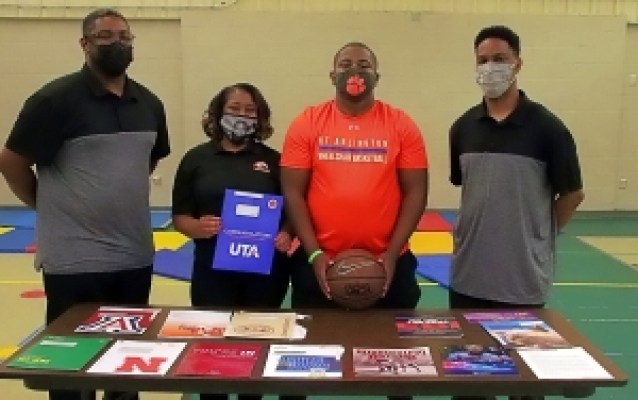 Devin White (third from left) celebrates his college options and choice of the University of Texas-Arlington to play Adaptive Basketball with (l-r) Coach Delton Shoates, mother Monica White, Devin, and Coach Everette Shoates. Not pictured is his father, Darrell White who had to miss due to work obligations. (Photo by Mark Brock)