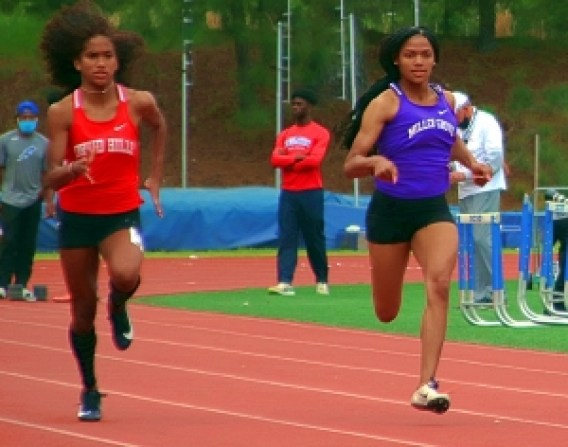 Druid Hills Sanaa Frederick (left) and Miller Grove's Angelica Frederick (right) finished 1-2 in the Region 6-4A 100 and 200 dashes. (Photo by Mark Brock)
