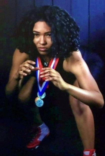 Stone Mountain 2021 graduate Daisy Gilleylen became the first DeKalb County female wrestler to sign a scholarship to compete in college. The state medal winner begins her college career on November 6. (Courtesy Photo)