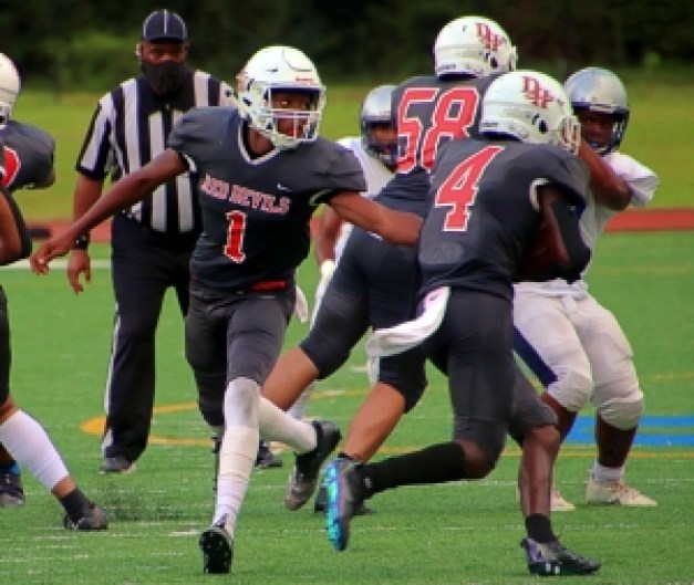 Druid Hills running back Zeke Nshimiriomana (4) takes a handoff from quarterback Jacquez Cullars (1) and follows a block by lineman Jack Hart (58) in a game earlier this season. Druid Hills takes on Clarkston tonight (Thursday) in a 7:00 pm game at Hallford Stadium. (Photo by Mark Brock)