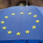 STRASBOURG, FRANCE - MAY 12: An umbrella adorned with the EU flag is carried by a protester during a march against employment laws in the centre of Strasbourg on May 12, 2016 in Strasbourg, France. The United Kingdom will hold a referendum on June 23, 2016 to decide whether or not to remain a member of the European Union (EU), an economic and political partnership involving 28 European countries, which allows members to trade together in a single market and provide free movement across it's borders for cirtizens. (Photo by Christopher Furlong/Getty Images)