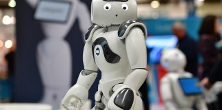 HANOVER, GERMANY - JUNE 12: NAO, the first built humanoid robot, entertains visitors at the SoftBank Robotics stand at the 2018 CeBIT technology trade fair on June 12, 2018 in Hanover, Germany. The 2018 CeBIT is running from June 11-15. (Photo by Alexander Koerner/Getty Images)