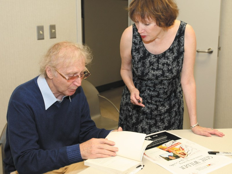 Actor Gene Wilder signs a book for Atlanta film critic Eleanor Ringel Cater during the 2009 festival. Wilder is returning this year.